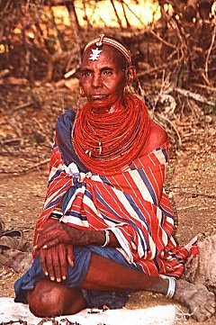 Samburu woman offering trinkets.