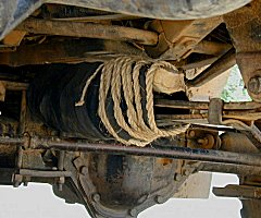 Chep makes a great 'MacGyver'. African 'bush repair' to broken leaf spring.