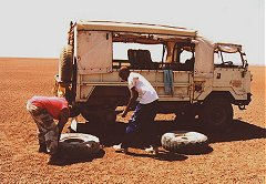 'Field fixing' one of many flat tires.